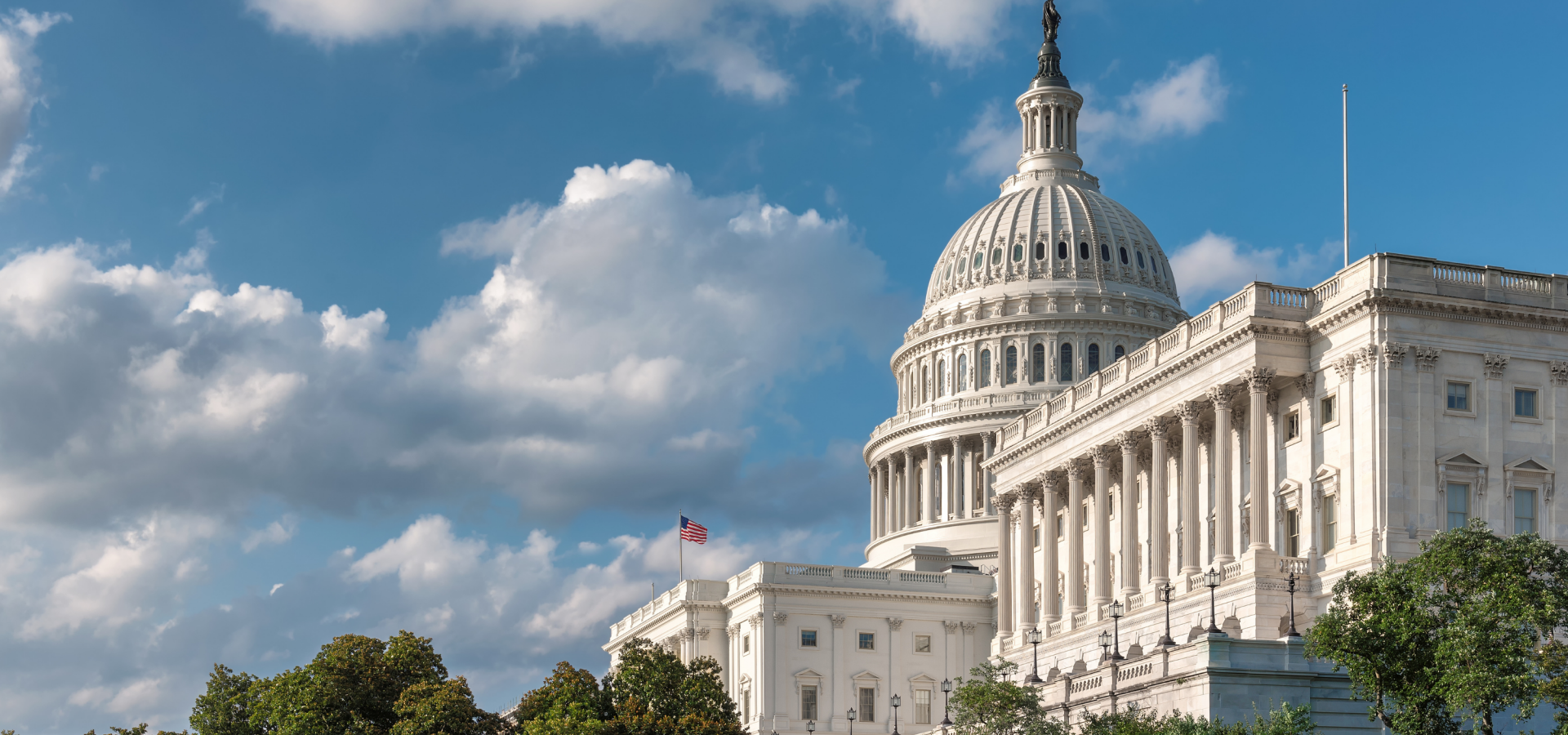 A photo of the front of the United States Capitol from the right side.