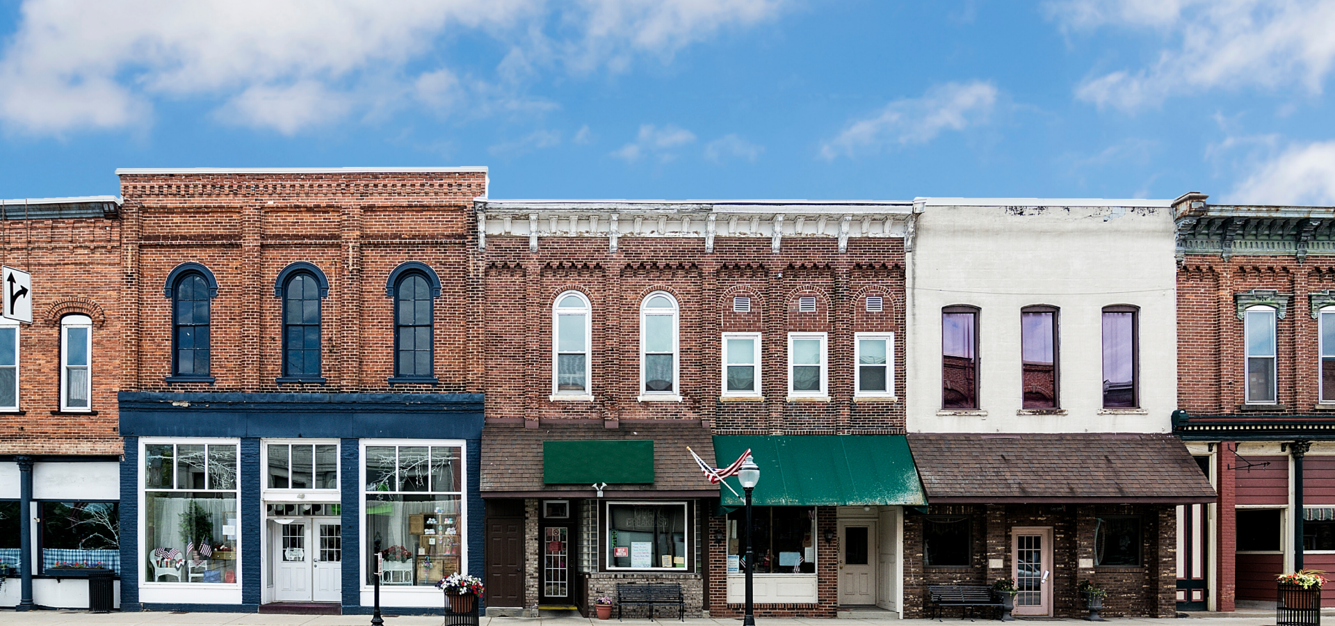 Brick storefronts line a main street in a small town.